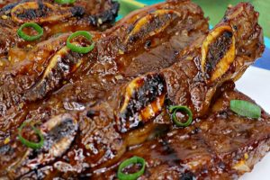 picture of asian hawaiian bbq short rib on a white tablecloth