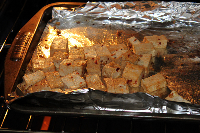 Toss the tofu with about 2/3 of the sauce. Save the remaining sauce ...