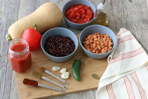All the ingredients needed to make a vegetarian chili laid out before we start cooking.