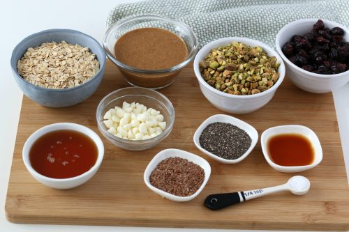 All the ingredients you need to make no bake energy balls laid out and ready to be made into power balls!