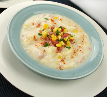 Freshly prepared ham corn and potato chowder with paprika