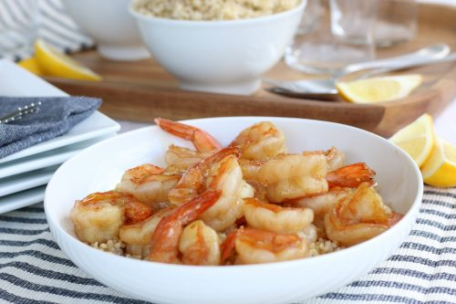 Perfectly cooked honey garlic shrimp over rice. Final product of how to cook shrimp properly!