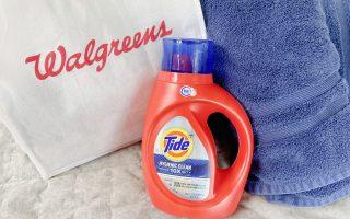 Tide Bottle near Walgreens bag with blue bath towels