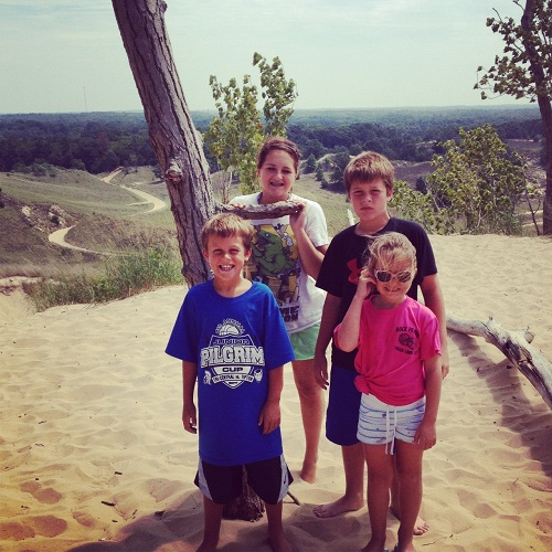 kids at top of dune ride in saugatuck