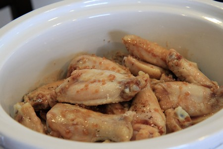 pour ingredients over wings in slow cooker