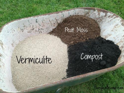 raised garden beds soil mixing in wheelbarrow